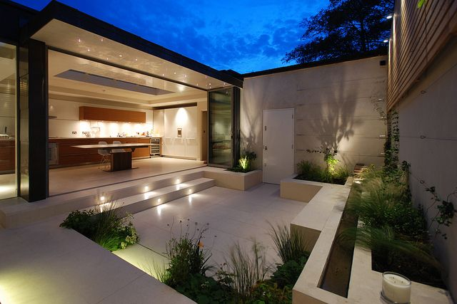 Chelsea Courtyard | Small courtyard with limestone terrace and raised planters | Charlotte Rowe Garden Design
