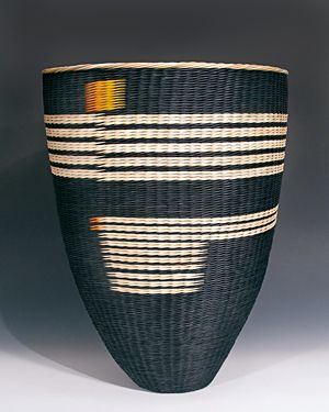 Handwoven, contemporary basket made of artist dyed rattan reed, using watersafe, commercial fabric dyes. © Kari Lonning 2014