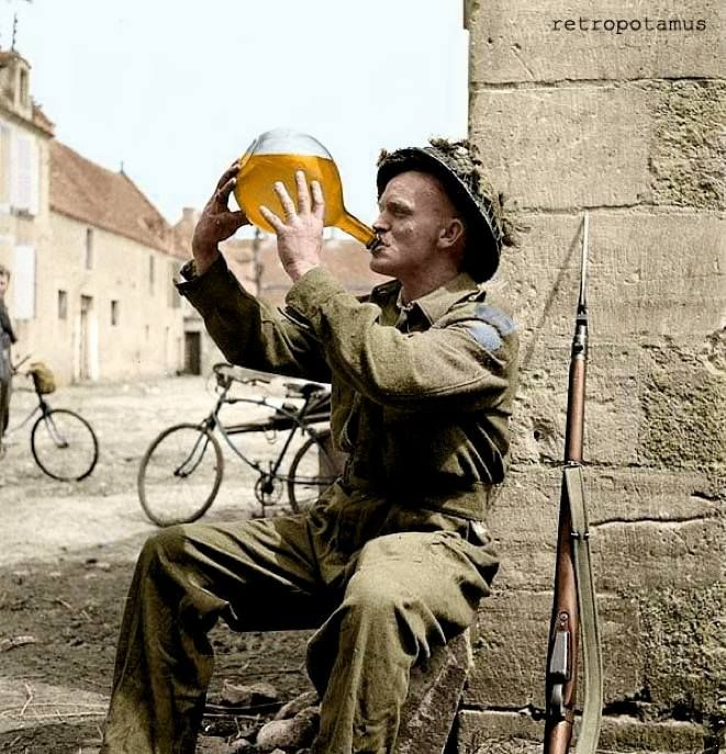 Cider Man - Sergeant C. Orton of the Highland Light Infantry of Canada with a jug of cider. June 20, 1944, France. Colorization by Retropotamus with additions by Doug Banks. -