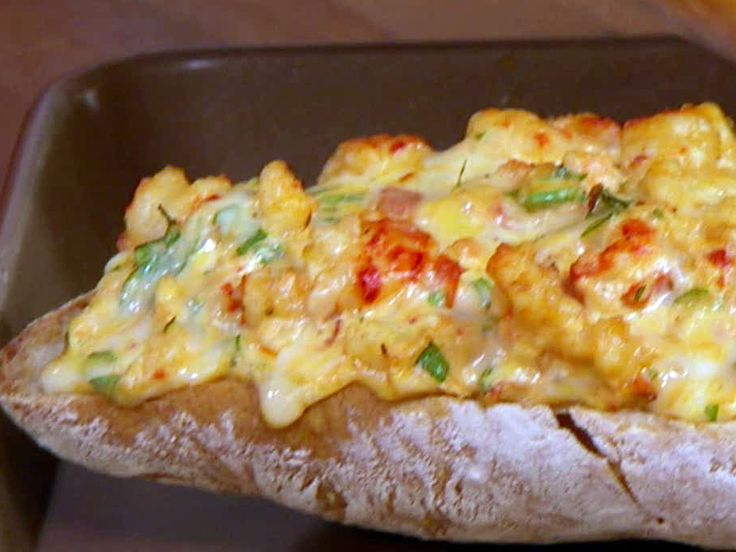 Crawfish Bread - I think I'd use Shrimp or lobster...    1 pound crawfish tail meat, peeled, cleaned and deveined  1/2 stick butter  1 clove garlic, minced  3/4 cup chopped and drained ripe tomatoes  1 tablespoon Cajun seasoning  3/4 cup Monterey Jack Cheese  1/4 cup grated Parmesan  1/2 cup mayonnaise  3 tablespoons chopped fresh parsley  1 loaf French bread