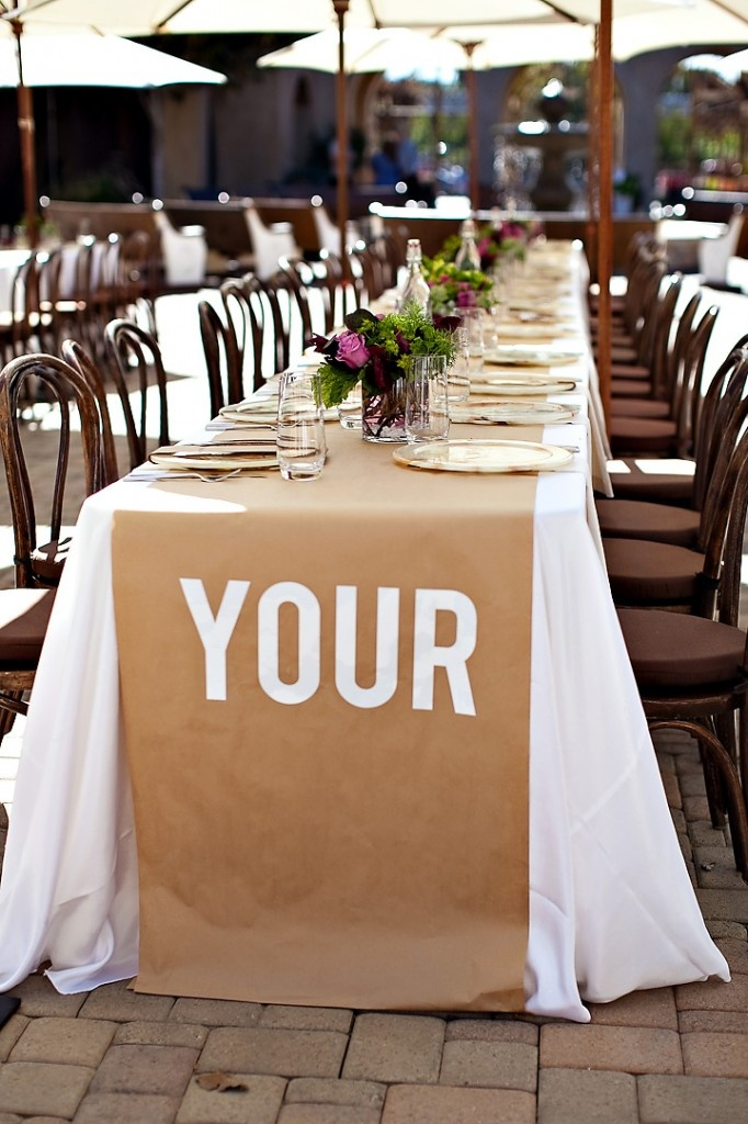 Brown paper table runners - cost effective! Would love to put crayons on the tables too for kids.