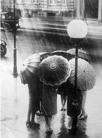 Vintage umbrellas in the pouring rain