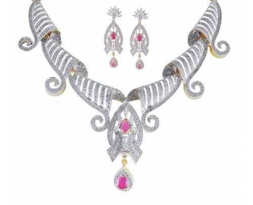 One of the most Pretty American Diamond Necklace Set by Rejewel.Necklace Set in Red colour studded throughout the piece makes you standout in the crowd.Flawless fit for your most awaited Evening.