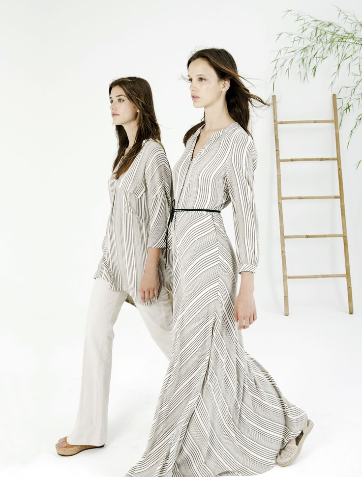 #twinning in this organic striped pattern. Model 1: flowing maxi dress, with beige Espadrilles.  Model 2: Tunic, white pants and orange sandals. From SS17 Collection - Indi & Cold