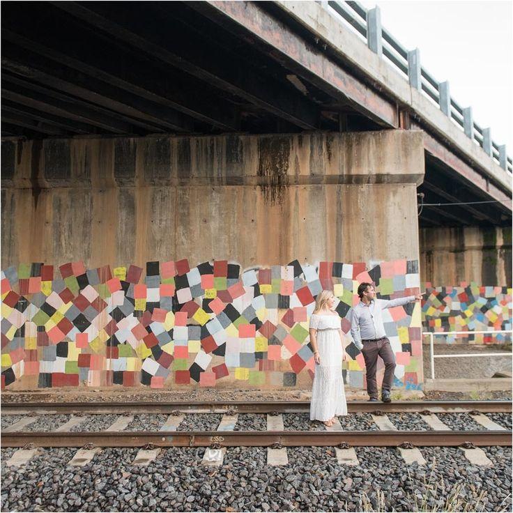 Engagement shoot ideas for loved up couples www.misterandlady.com.au #love #engagementshoot #funideas #lovedup #couplesportraits #engagement #weddingphotography #professionalphotography #weddings #colours #traintracks