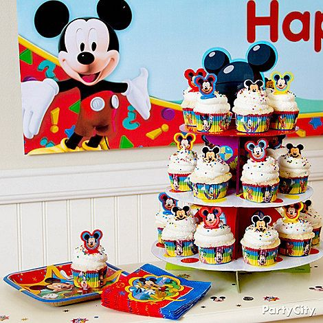 It's so easy to make this marvelous Matterhorn of Mickey Mouse cupcakes with cute cake toppers and a Mickey Mouse Cupcake Tower.