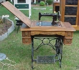 101 best treadle sewing machines images on pinterest treadle wheeler sewing machine the machine drops into the bottom cabinet so that it turns into a flat table interesting piece for the entry way instead of a sciox Choice Image