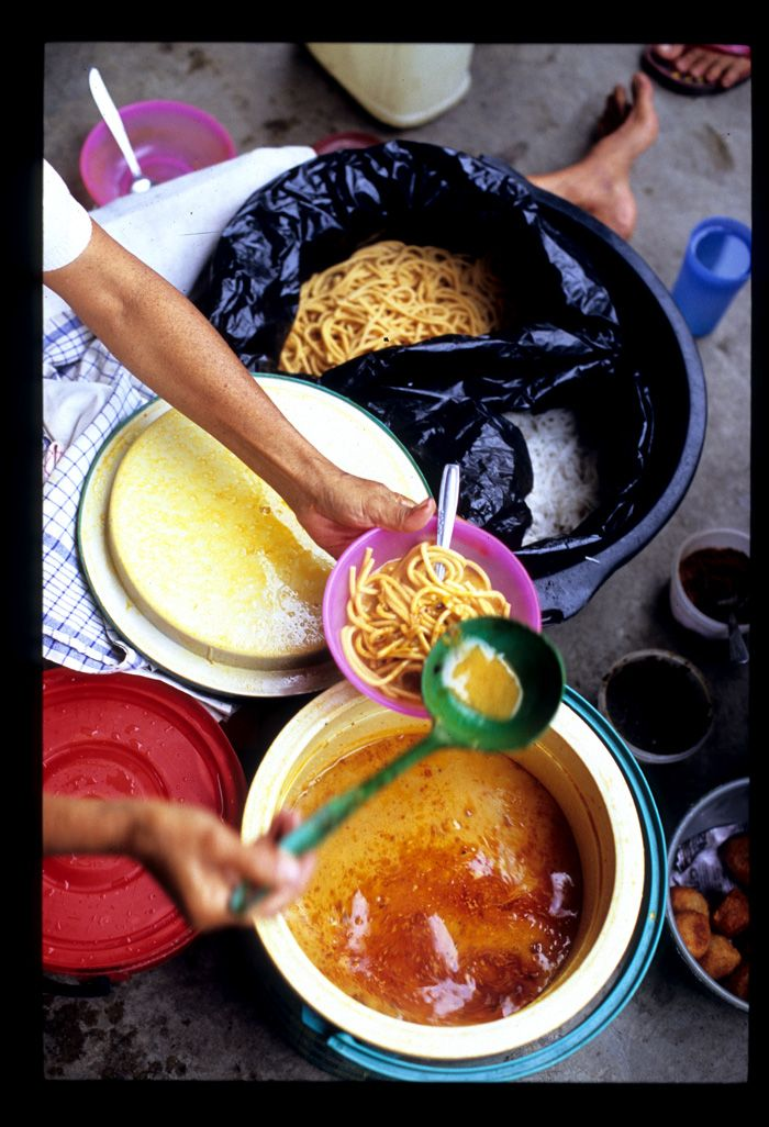 Gomak    The curry is red and coconuty, on the thin side but flavorful, not-too-spicy (but adequately seasoned with plenty of dry spices), and smooth, with no chunks of this, that, or the other meat or vegetable. The noodles are served alongside jars of add-as-you-like kerisik (grated, dry-fried coconut) and sambal andaliman, a zippy sauce made from a variety of prickly ash that's an essential part of the Batak culinary repertoire. The combination is at once familiar (coconut curry) and…