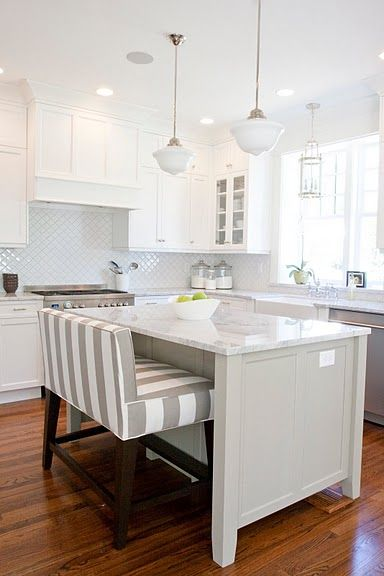 kitchen island: love the tall, padded bench instead of bar-stools.