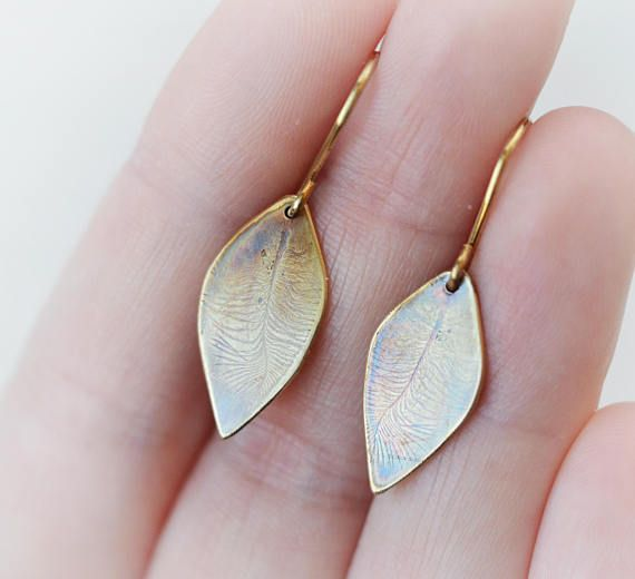 This is a golden colour brass earring made in my studio. Real little bird feathers were inprinted on the brass sheet (I have two little birds and they provided the very cute little feathers that they constantly shed - see black and white photo :) ). A bit of patina enhances the delicate, detailed design. The leaf shape shiny brass earrings is very versatile and cute! I made these earrings out of solid brass sheet with brass earwires. I HAVE STERLING SILVER EARWIRES available in my shop, so…