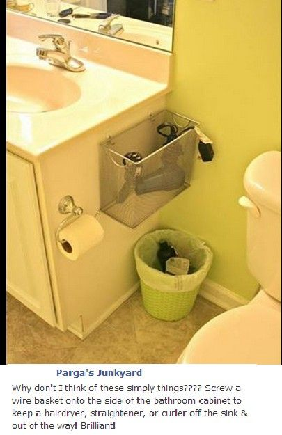 Bathroom storage- hubby will love this one...hang this on the inside of the under the sink cabinet door
