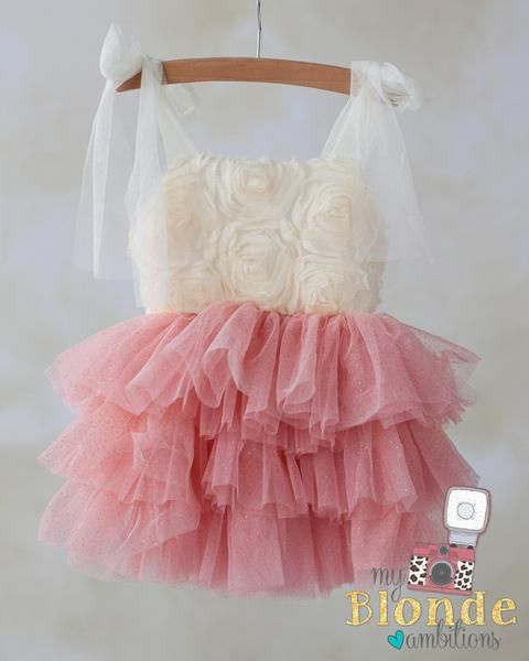 She can run and play in our Peach Princess Frolic Dress. Featuring a unique sparkle tulle skirt and cream rosette top. Has tulle straps for easy adjustment. This dress is perfect for portraits, especially her first birthday or cake smash! She'll frolic, play and twirl