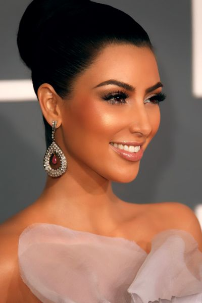 Kim Kardashian, you can say what you want about her, but, there is no denying that she is a very beautiful woman.....