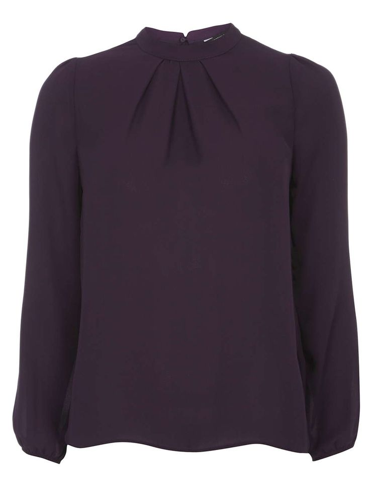 Would love to try a high neck blouse. This color is fabulous for fall and winter.