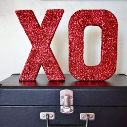 Turn plain old boring craft letters into sparkly decor with this easy and fun tutorial and some red glitter!