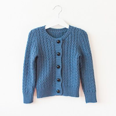 This is a vintage inspired children's cardigan. It is made in one piece from the…