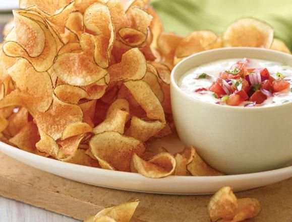 APPETIZER- POTATO TWISTERS A mountain of spiral-cut russet potatoes served with our spicy Queso Blanco and freshly-made pico de gallo.