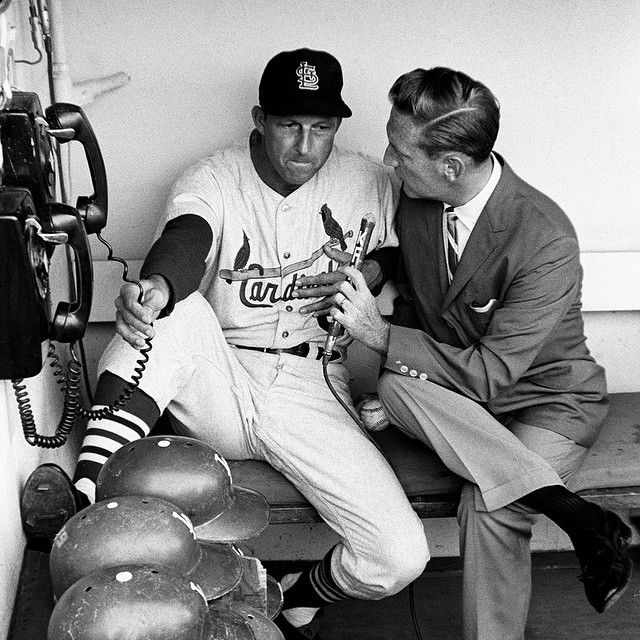 St. Louis Cardinals' Stan Musial talking to Los Angeles Dodgers' announcer Vin Scully in the dugout before a game at Dodger Stadium on August 22, 1963. Photo by: Neil Leifer for Sports Illustrated @sportsillustrated #sioriginals #sipicturecollection #neilleifer
