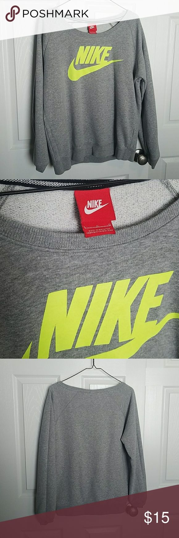 Nike women's sweatshirt Very comfortable grey Nike women's sweatshirt. It is a wide crewneck without kangaroo pocket. The emblem is a neon highlighter green / yellow. Super soft and comfortable. I just realized I wear hoodies more often than crewnecks so this is been in the back of my closet for a while. Nike Tops Sweatshirts & Hoodies