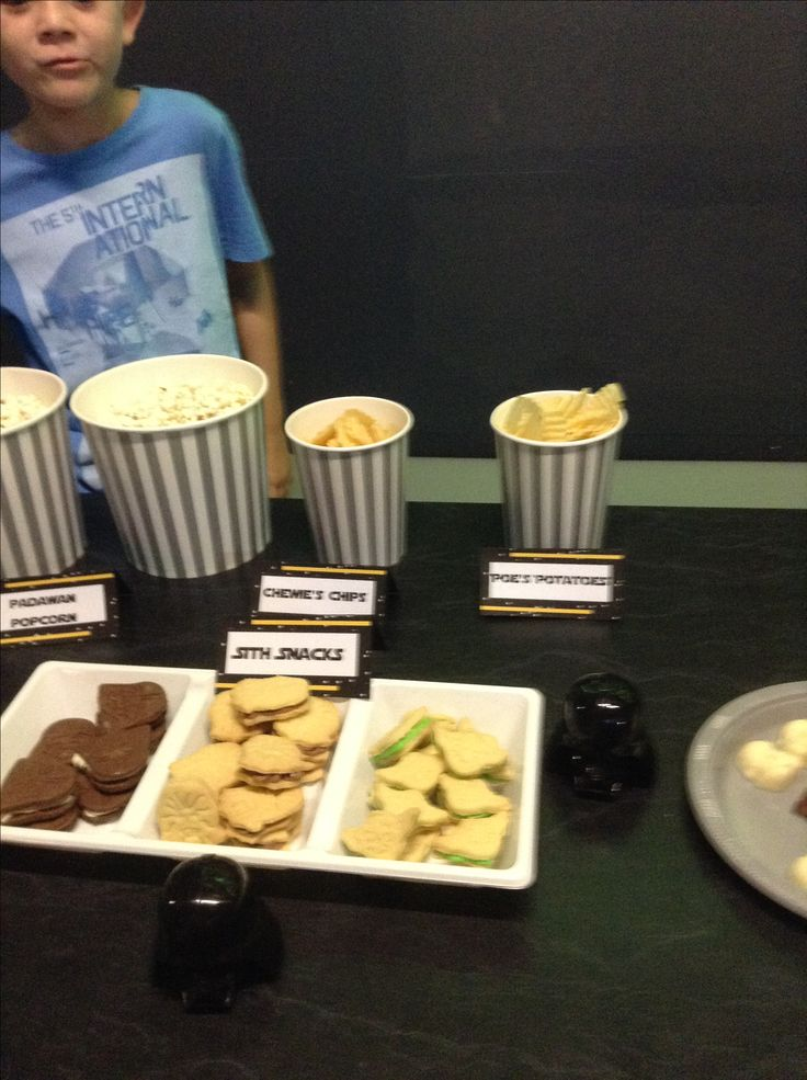 So, here are some of the foods we served at the party (unfortunately my son was in charge of the photography and forgot to take lots of photos).  Padawan Popcorn, Sith and Vinegar Chips (salt and vinegar), Po's Potato Chips, Droiditos (Doritos), Chewies Chips, Sith Snacks, Yoda Soda (green soft drink), Hans Solo (Solo lemon drink) and Luke Skywater (bottles of water).