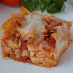 Baked Ziti Casserole Recipe - Allrecipes.com Original recipe makes 8 servings  1 (16 ounce) package ziti  1 (15 ounce) container ricotta cheese  1 1/2 cups tomato sauce  1 (8 ounce) package shredded mozzarella cheese  1 egg, slightly beaten  1 teaspoon salt, or to taste  1/2 teaspoon ground black pepper, or to taste  2 cups tomato sauce, divided  1/4 cup grated Parmesan cheese