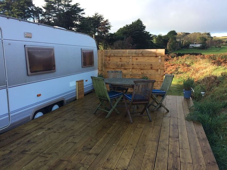 Camper/RV in Brittas Bay, Ireland. aravan moments walk through the sand dunes on to the sandy beach of Brittas Bay. Our caravan sleeps 2 adults and 2 children.  A separate double bedroom with two children bunk beds. Enjoy the evening sunset and bbq on the decked veranda. Close to a...