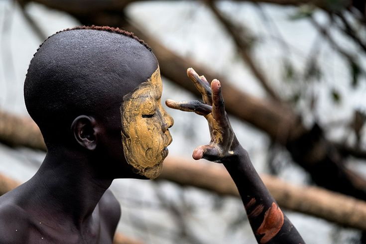 A boy from the Suri tribe having his face painted in Kibish, Southwestern Ethiopia © Susan Greeff - A boy from the Suri tribe having his face painted in Kibish, Southwestern Ethiopia © Susan Greeff