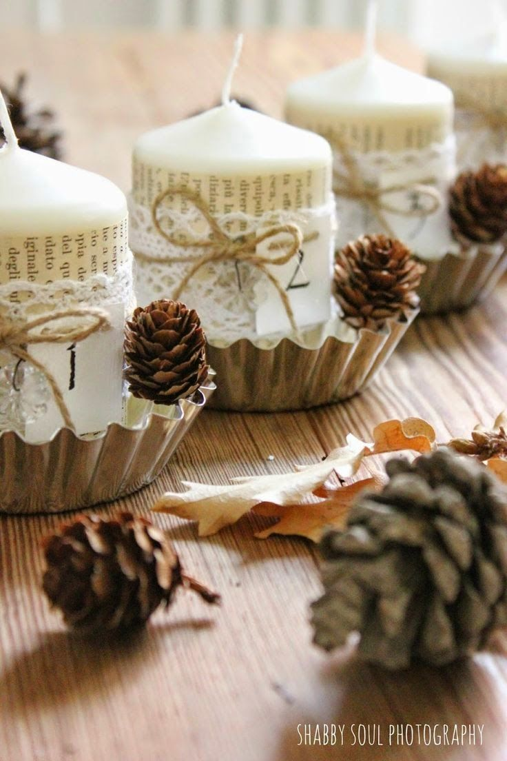 candles wrapped in book paper, twine & lace placed in  muffin tins:
