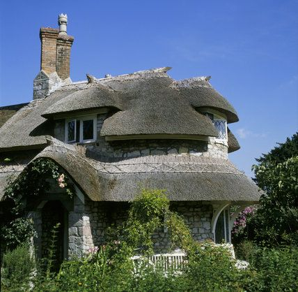 One of the picturesque cottages designed by John Nash in 1809 for Quaker banker and philanthropist John Harford, to accommodate Blaise Estate pensioners, Wessex, UK