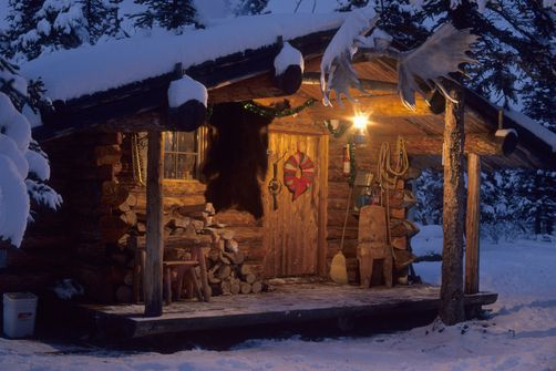 Small Log cabin in the Alaskan Wilderness at Christmastime.