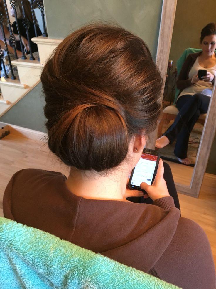 Sleek yet messy bun. New age French twist. Brunette. Bridal.