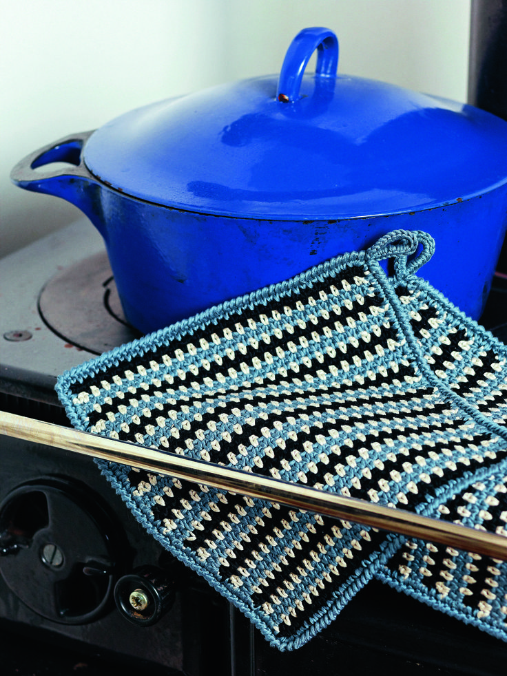 Black and Blue Striped Potholder from Crochet for the Kitchen-Over 50 Patterns for Placemats, Potholders, Hand Towels, and Dishcloths Using Crochet and Tunisian Crochet Techniques by Tove Fevang.