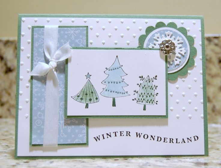 """Stamps: Cute Christmas and ?. Ink: Basic Black, Baja and Garden Green. CS: Garden Green, Whisper White. DSP: Candy Cane Christmas. Punches: Scalloped Circle, 1- 3/8"""" Circle, 1-1/4"""" Circle. Big Shot: Polka Dot Embossing Folder, Snowflake Strip. Accessories: Markers, Daubers, White Taffeta Ribbon, Filigree Brads. To color the trees create a mask and use daubers to color - then add a little accent with the markers."""