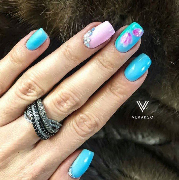 If long nails cut into the semisquare and take a bright blue and milky-pink gel-varnishes for the work, it can be a great original manicure. The nails are painted by blue varnish, the ring – is an exception, it is used a pink varnish for it. On the nail on middle finger you can draw flowers or use…