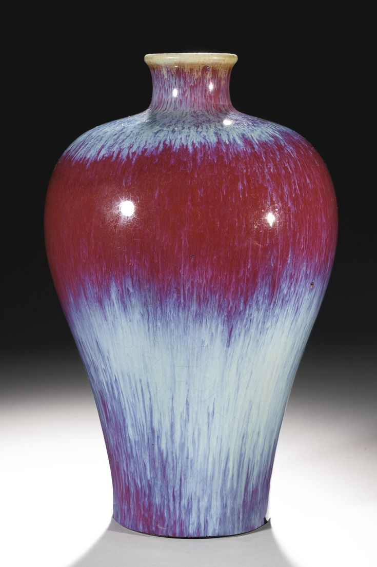 A RARE FLAMBE-GLAZED VASE (MEIPING)  QIANLONG SEAL MARK AND PERIOD. rising from a slightly splayed foot to a high-shouldered body below a short, waisted neck, covered overall in a rich purplish-red glaze with lavender streaks thinning to mushroom around the mouth, the base covered in a mottled mushroom-brown wash over the incised seal mark