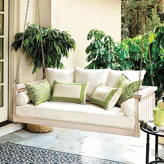 pretty porch swings for an inviting front patio