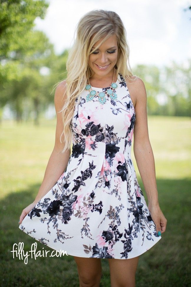 A gorgeous floral dress that would be perfect to wear to a wedding!