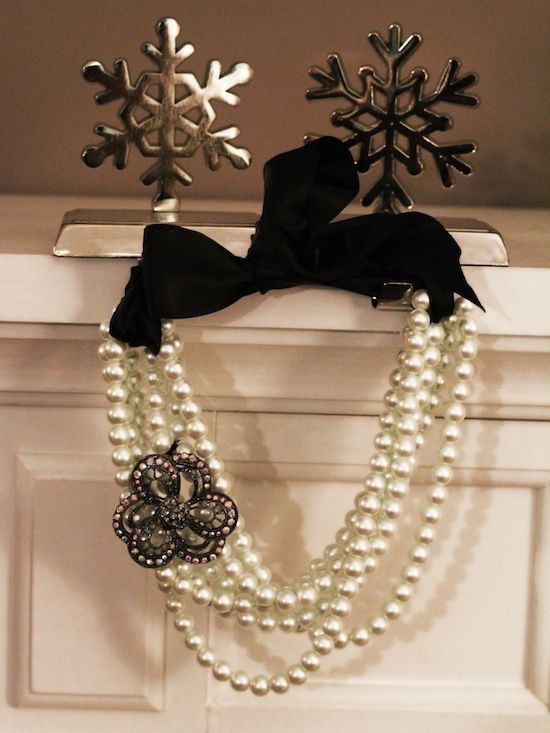 Easiest DIY EVER. Pre-strung pearl necklaces- fold them in half, loop large, velvet ribbon through each open end- tie in a bow, add a sparkly brooch (if you want to) and DONE! Gorgeous.