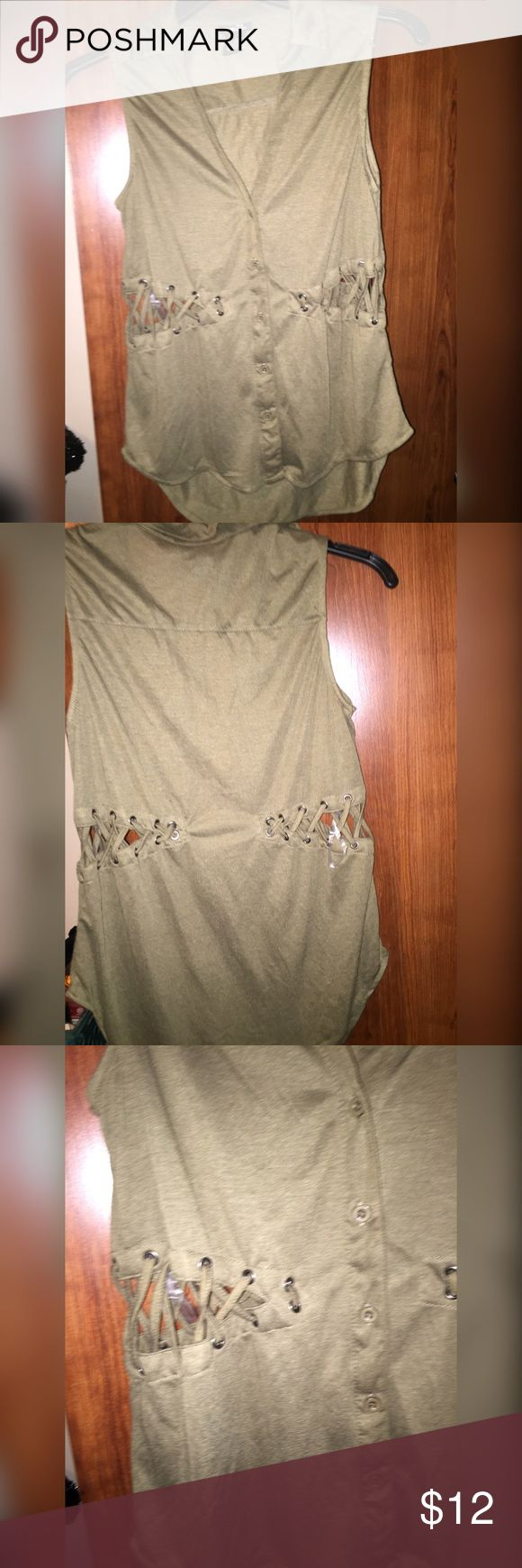 Forest Green Sleeveless Side Cut Shirt  CONDITION : perfect condition wore once   NO : stains or holes except cut out which was how it's made  COLOR : dark forest green    Fit: S to M  Size:  M ALWAYS: 1-2 day shipping & use make an offer button !!!!!!   NOT : Trading Tops