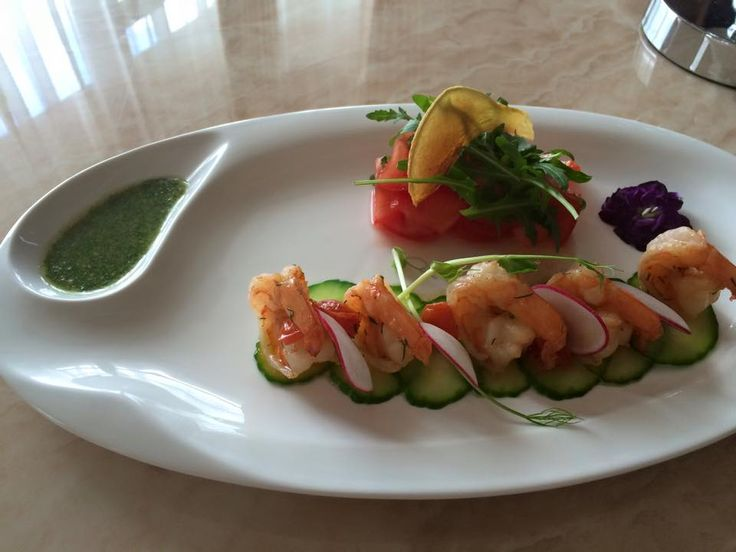 Fried tiger prawns in garlic sauce served with honey tomatoes and coriander