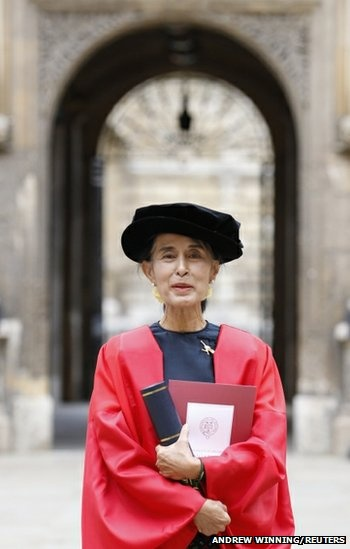 Pro-democracy leader Aung San Suu Kyi poses for a photograph after receiving her honorary degree at Oxford University