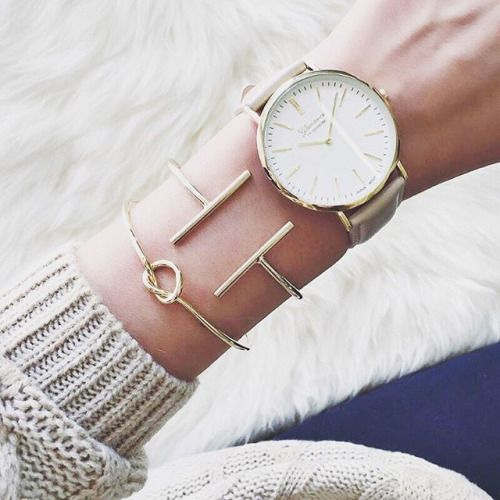 Chunky watch with delicate bracelets.: