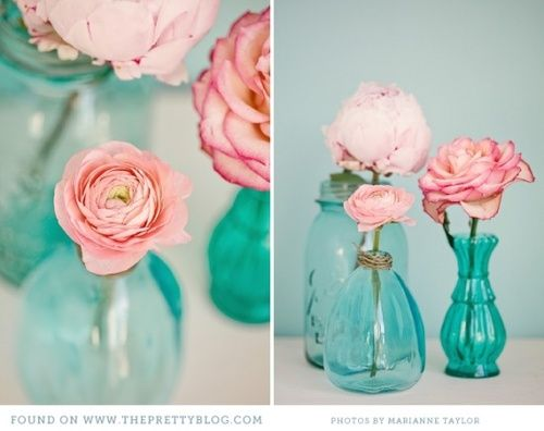 pink roes in teal vases