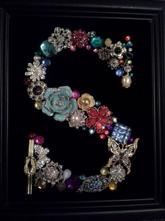 "Vintage and costume jewelry on black velvet in the shape of the letter ""S"" framed for display on Etsy, $65.00"