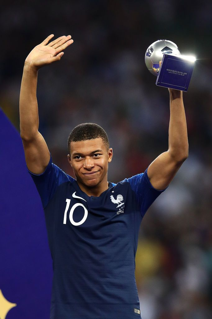 e8afe26f01b Kylian Mbappe of France waves to the crowd holding the Best Young ...