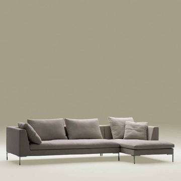 For a straightforward and super comfortable sectional, choose the City Sofa. It features feather down-filled upholstered back cushions and pillows.