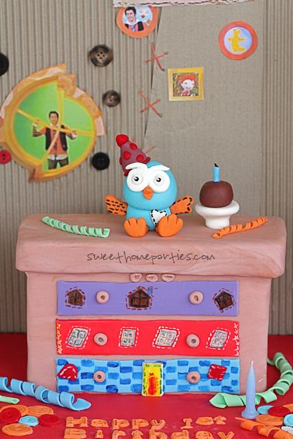Chocolate mudcake carved and ganached covered with fondant .Setting is from Hoots house Jimmy Giggle and Hoot the Owl are two best mates, living together in their wonky, recycled house.