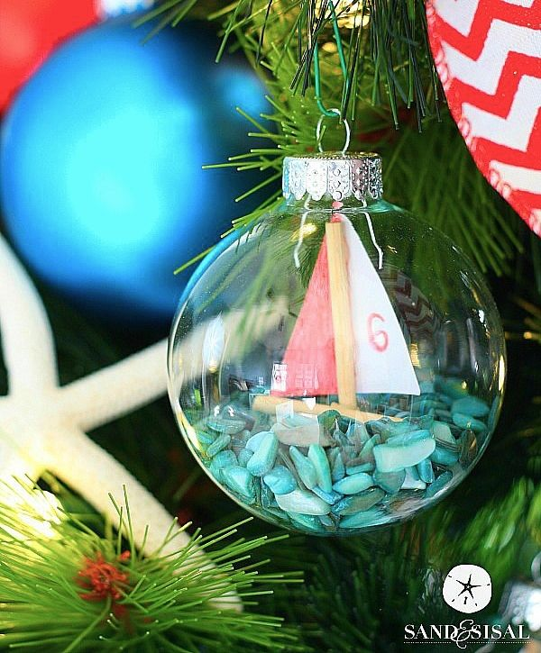 If you love a nautical Christmas tree or a Coastal Christmas tree then you will love these DIY Sailboat Ornaments! It's like the ship in the bottle!