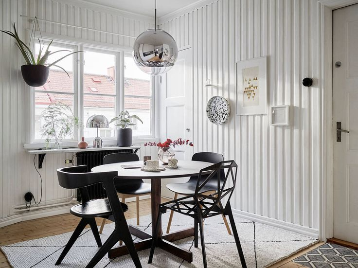 Small space black and white dining room design.