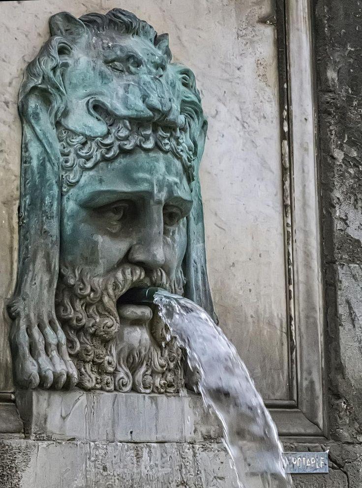 A bronze fountain depicting Hercules wearing the Nemean ...